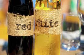 homemade wine bottles with burlap