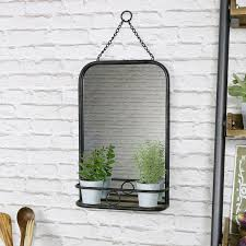 black metal industrial wall mirror with