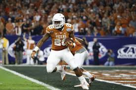 Texas RB Malcolm Brown entering NFL ...