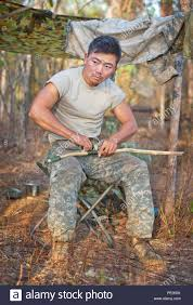 U.S. Army 2nd. Lt. Jae Yu with the 25th Infantry Division, U.S. Army  Pacific, winds cord around a navigation stick during Exercise Kowari 2015,  being held in the Daly River region of