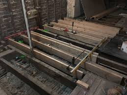 sistering joists and getting floor