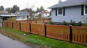 It Would Be Great To Find A Fence Similar To This For My Yard Because It Is Functional And Stylish It Is The Perfect Wooden Fence Light Blue Houses Wood Fence