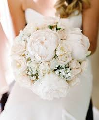 elegant mix of peonies roses and baby