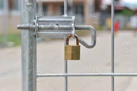 Steel Fence Locked With Padlocks Lock On A Gate Stock Photo 69c4dfa5 4036 4fe7 Ab2a 356021ced1ba