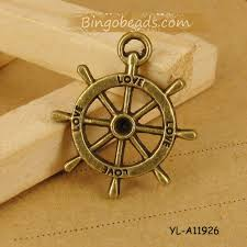 vintage jewelry charms ship steering