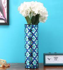 blue glass vase by home