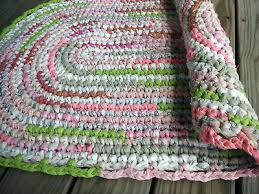 oval crocheted rag rug pink green