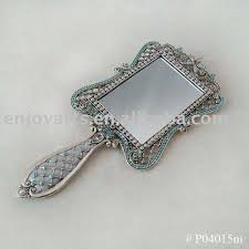 silver hand mirror with square mirror