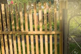 Rustic New Wooden Fence With Black Metal Posts And Gates Garden Stock Photo Picture And Royalty Free Image Image 128938872