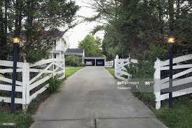 White Fence And Lamp Posts At End Of Driveway High Res Stock Photo Getty Images
