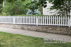 Image Result For Stone Retaining Wall With White Fence White Picket Fence Picket Fence Garden Picket Fence