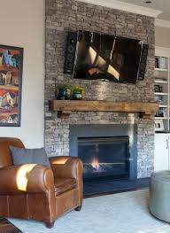 wood mantle above this fireplace