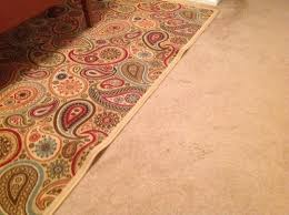 how to keep area rug on carpet flat