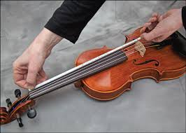 tape fingerboard guides on your violin