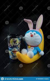 Bangkok, Thailand - October 6, 2019 : Cute Toy Of Doraemon Sit On The Half  Moon. Set Of Bucket Popcorn And Soft Drink Editorial Stock Photo - Image of  kids, drink: 160359048