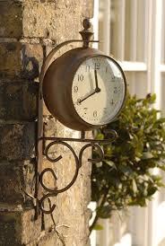 antique rust outdoor clock and