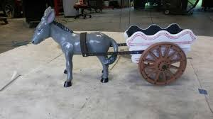 concrete donkey with cart with images