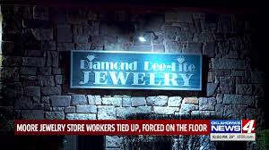 armed masked man ties up moore jewelry