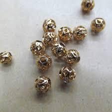 metal er beads carved gold