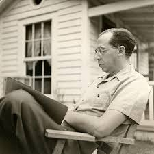 Aaron Copland outdoors reading; at Tanglewood studio | Library of Congress