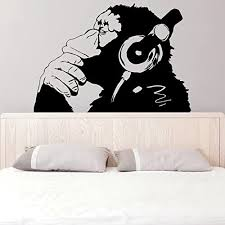 Amazon Com 39 X 27 Banksy Vinyl Wall Decal Monkey With Headphones One Color Chimp Listening To Music In Earphones Street Graffiti Sticker Free Decal Gift Home Kitchen
