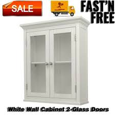 white storage pantry with glass doors