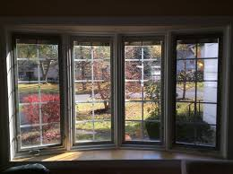 pella bow window with blinds between
