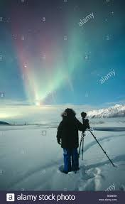 Alaska. Aurora borealis or northern lights. A photographer (Ellen ...
