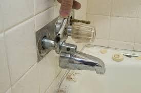 fix a leak in a wall by the bathtub