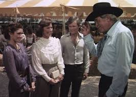 "HOWARD KEEL as ""Clayton Farlow"" with MORGAN BRITTANY (Katherine Wentworth), PRISCILLA  POINTER (Rebecca Barnes We… 