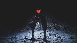 people kissing winter snow night