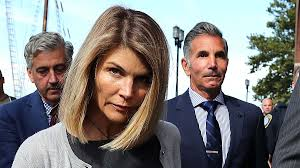 Lori Loughlin sentenced to two months in prison for college ...