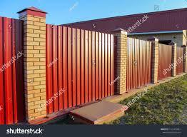 Brick Metal Red Fence Door Gate Stock Photo Edit Now 1121475881