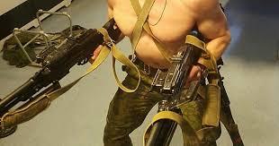 Finnish soldier dual-wielding two light machine guns. (r ...