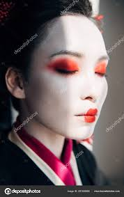 geisha red white makeup closed eyes