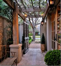 Arbor Between House And Fence Or Space From A Detached Garage What A Clever Way Of Integrating Dead Space Like Adding Square Footag Backyard Side Yard Patio