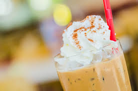 barista with homemade iced coffee