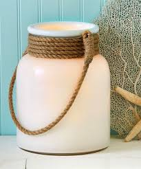 white glass lantern with rope handle