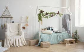 Decorated Kids Bedroom With Covered Armchair And House Shape Stock Photo Picture And Royalty Free Image Image 135354682