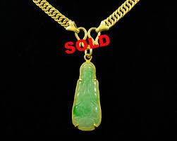 24ct gold mounted jade buddha pendant