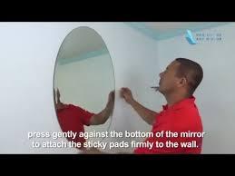 oval frameless wall mirror installation