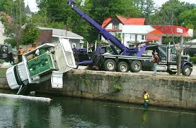 truck goes in river rescuers jump in