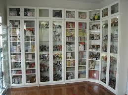 white ikea bookshelves with glass doors