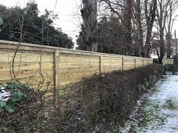Acoustic Noise Barrier Fence Provides Sound Reduction From Busy Road Jacksons Fencing