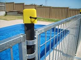 A Black Star Pickets With Yellow Plastic Cap Are Connecting Temporary Pool Fencing Pool Fence Temporary Pool Fencing Pool