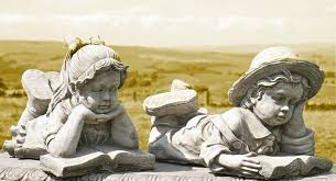 pair of garden ornaments of boy and
