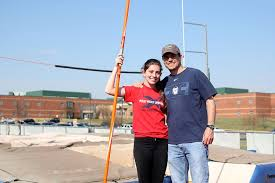 Pole vaulting serves as bonding activity between junior Abby ...