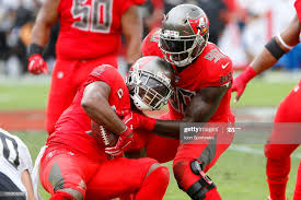 Adarius Taylor of the Bucs smiles as he is helped up by Jason... News Photo  - Getty Images