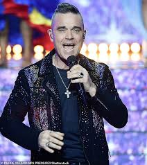 Robbie Williams is set to take after Simon Cowell and become a TV ...