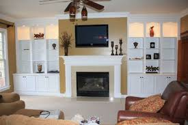 built in wall units with fireplace